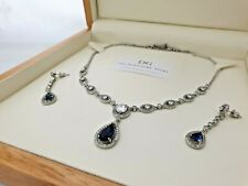 White gold finish pear cut blue sapphire and created diamond necklace earrings