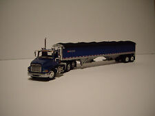 DCP 1/64 BLUE INTERNATIONAL 9100i DAYCAB AND BLUE WITH BLACK TARP GRAIN TRAILER