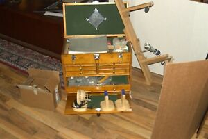 Complete Fly Rod Building Setup with many rod blanks and all materials.