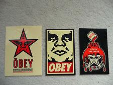 Un trío de obedecer también conocido como Shepard Fairey Pegatinas