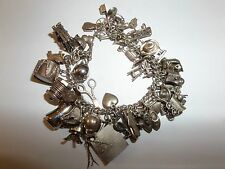 VINTAGE STERLING SILVER CHARM BRACELET ABOUT 47 CHARMS 84.7 GRAMS WOW WAS $250!
