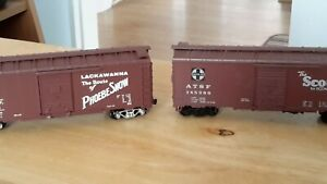 PAIR OF UNBRANDED HO WAGONS,SANTAFE,ATSF.145388.AND D.L.AND W.51966.