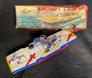 VINTAGE JAPAN TIN FRICTION US NAVY AIRCRAFT CARRIER WITH FLYING HELICOPTER & BOX