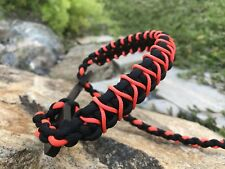 Weber bow wrist sling orange and black with a orange micro braid X weave