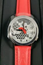 Akteo watch design by JC Mareschal red high heel shoe is second hand lace dial