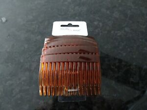 NEW PACK OF FOUR LADIES HAIR COMBS