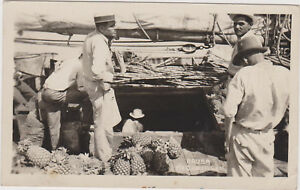 RP: ARUBA , N.W.I. , 1951 ; Man selling Pineapples out of Boat