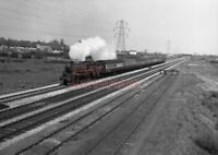 PHOTO  BR LOCO 75009 AT RUMNEY ON 22ND APRIL 1954