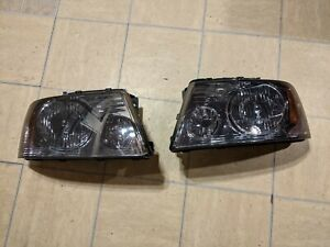 2006 FORD F150 AFTERMARKET SMOKED HEADLIGHTS 1