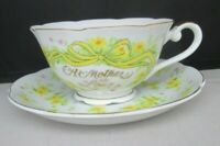 A Mother is Love Hand Painted JAPAN Porcelain Tea Cup Yellow Ribbon and Flowers