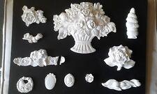 11 moulages pour décoration en platre : fleurs, médaillon divers
