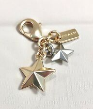 COACH GOLD/SILVER METAL SET OF 2 STARS SMALL CHARM  GOLD/SILVER NWOT