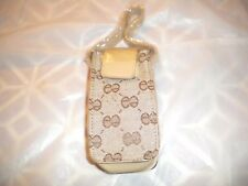 NEW BEIGE  CELL PHONE POUCH WITH DESIGN  AND  A   STRAP FOR THE PURSE