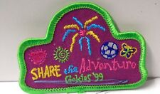 "VINTAGE ""SHARE THE ADVENTURE GIRL SCOUTS"" SEW  ON FABRIC PATCH 3"" W X 2"" H"