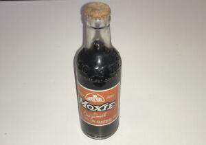 OLD MOXIE SODA BOTTLE - NEEDHAM HEIGHTS BOSTON MASSACHUSETTS - 7 OZ FULL BOTTLE