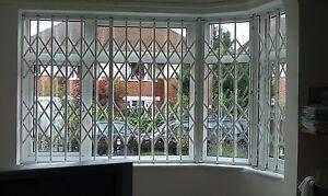 RETRACTABLE SECURITY GRILLE, SECURITY GRILLS, WINDOW GRILLES, DOOR GRILLES,