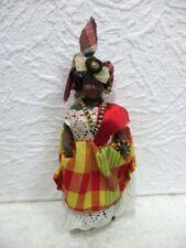 Ancienne poupée folklorique antillaise en celluloid à l'aigle