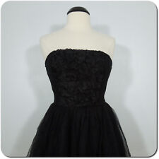 BEBE Black Strapless Cocktail/Party Dress.Chiffon Skirt, Floral Detail on Front