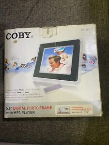 New With Box Coby DP-562 Digital Photo Frame MP3 Playback Video Music Remote