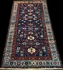 A Superb Black Ground Decorative Caucasian Runner rug