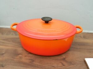 le creuset  cast iron  casserole dish and lid in orange  size F