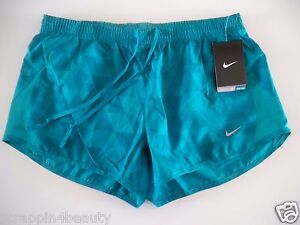 575097-311 New with tag Nike Women's 5K running shorts with liner printed green