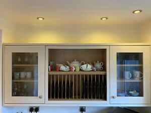 Wall Mounted Howdens Plate Rack With Glass Fronted Cupboards In Burford Cream