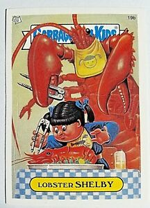 GARBAGE PAIL KIDS 19B LOBSTER SHELBY STICKER CARD W GUTSY GABRIEL PIC GPK-21