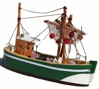 Wooden green hulled model trawler with hanging realistic fishing nets