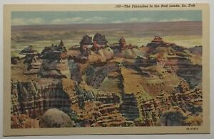 South Dakota Postcard Featuring The Pinnacles In The Bad Lands