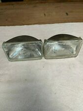 LOT OF TWO RECTANGULAR HEADLIGHTS. ONE SYLVANIA. H4651. ONE GE. 4332. 12V DOT.