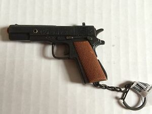 Pistol 45 Auto Miniature Replica  Firing caps Key Chain NEW MADE OF METAL & PLAS