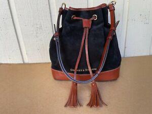 Dooney & Bourke bucket style, drawstring, Suede leather handbag. Elegant. Black