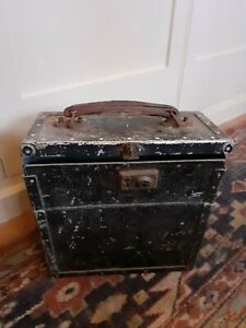 Vintage metal storage box with hinges and leather handle