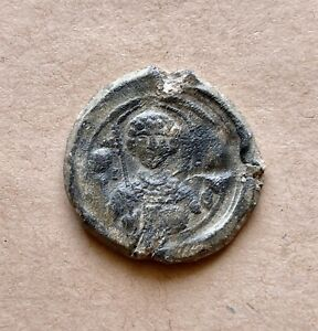 Byzantine lead seal of a Michael Raderos with archangel Michael (11th c.). Rare!