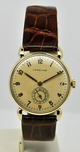 Longines solid 14K yellow gold manual wind watch ref:4999