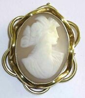 A VICTORIAN SHELL CAMEO BROOCH IN A GOLD TONE MOUNT