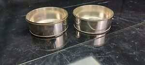 A Pair Of Matching Antique Silver Plated Wine/champagne Bottle Coasters.ornate.