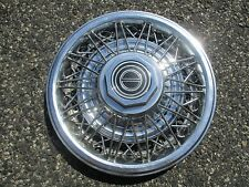 one 1982 to 1984 Ford Mustang 14 inch wire spoke hubcap wheel cover