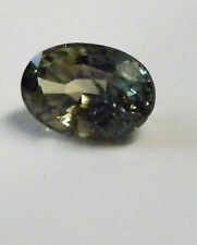 Natural Australian earth-mined  green yellow oval sapphire ..0.65  carat