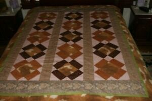 Twin size quilt with animal prints