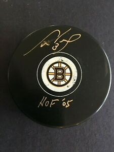 """CAM NEELY AUTOGRAPHED BRUINS PUCK W/ """"HOF 05"""" INSCRIPTION  C.O.A. INCLUDED"""