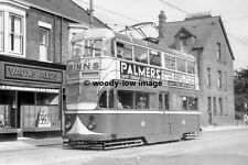 a0135 - Sunderland Tram no 51 by Vaux's Ales Shop on way to Roker - photograph