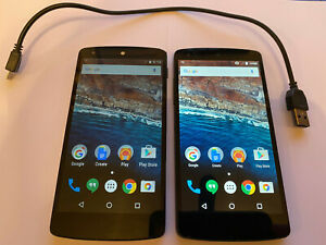 LG Nexus 5 Phones,2 one black and one white, and chargeing cord