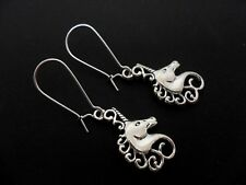 A PAIR OF  UNICORN EARRINGS ON SILVER PLATED KIDNEY EAR WIRES. NEW.