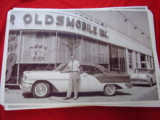 NEW 1957 OLDSMOBILE 4DR HARDTOP IN FRONT OF DEALER  11 X 17  PHOTO PICTURE