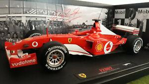 F1 FERRARI F2002 SCHUMACHER FRANCE GP 1/18 HOT WHEELS ELITE MATTE N2076 formule1