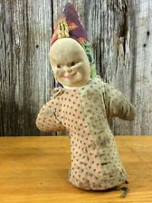 Antique slightly creepy jack in the box doll pressed cloth face coil body