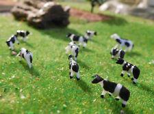 20 schwarzbunte Kühe in verschiedenen Posen, Spur N