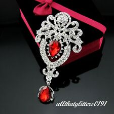 Clear Crystal Brooch With A Red Droplet Stone On A Rhodium Plated Frame